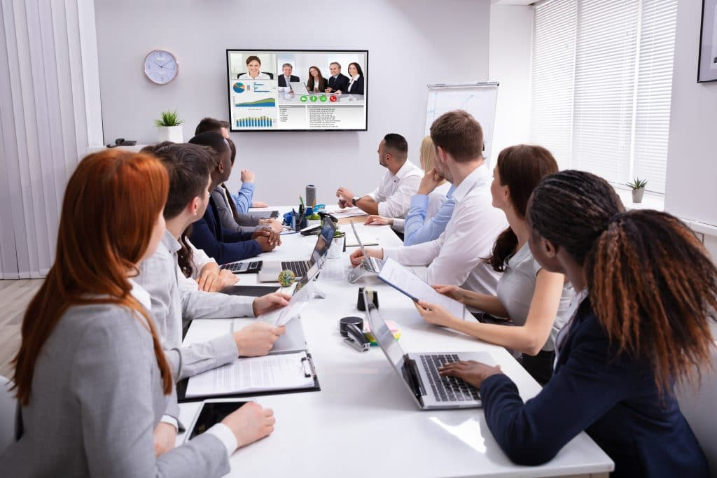 A group of young professionals participating in a productive conference call.