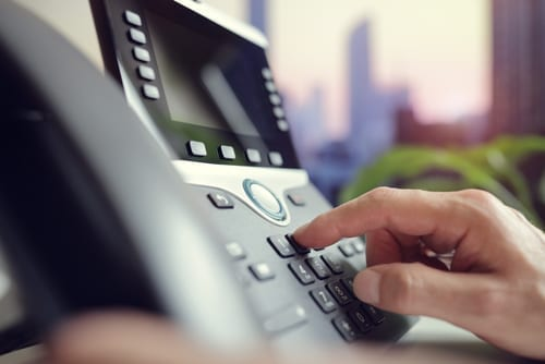 Someone-dialing-an-office-phone